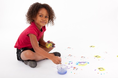 children painting: Cute Little African American girl painting on the floor