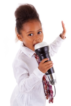 sings: Cute little African Asian girl singing,  over white background Stock Photo