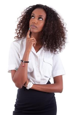 hesitating: Joven mujer de raza negra mirando hacia arriba, aislados en fondo blanco Foto de archivo