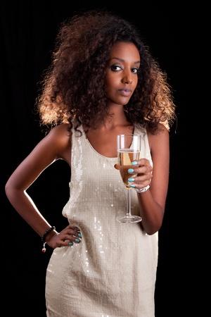 american sexy: Молодая красивая афро-американских женщина с бокалом шампанского Фото со стока
