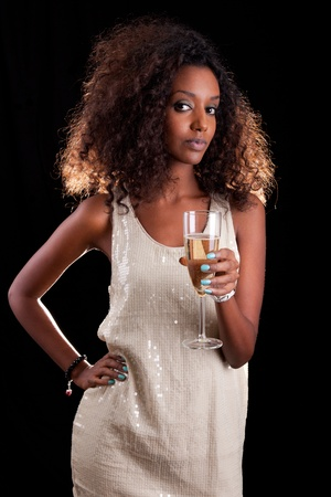 african american woman: Young beautiful African American woman holding a glass of champagne Stock Photo
