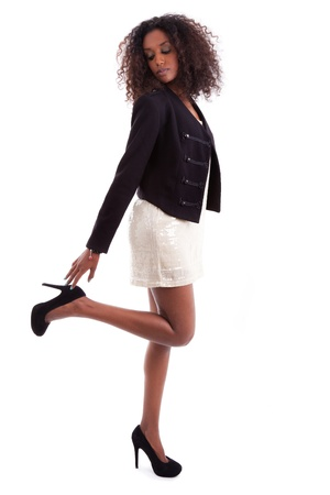 legs heels: Young beautiful African American woman , isolated on white background