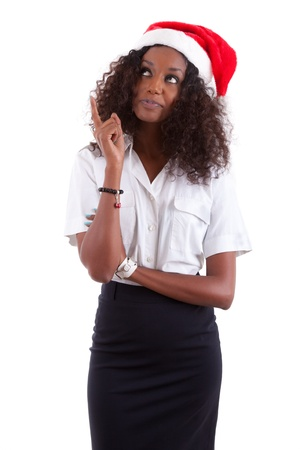 Young African American woman wearing a santa hat, isolated on white background Stock Photo - 11059328