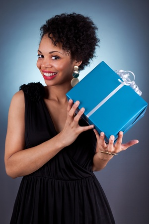 young african american woman: Young African American woman holding a gift box