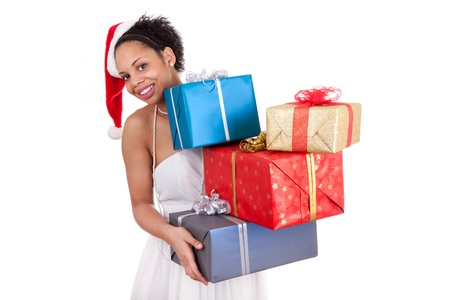 Young African American woman wearing a santa hat and holding a gift box photo