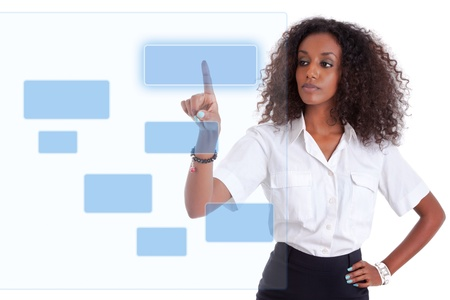 pushing the button: Young african american business woman pushing or pointing a transparent screen isolated on white background