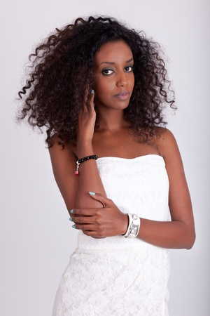 african american woman hair: Portrait of a young beautiful African American woman with curly hair