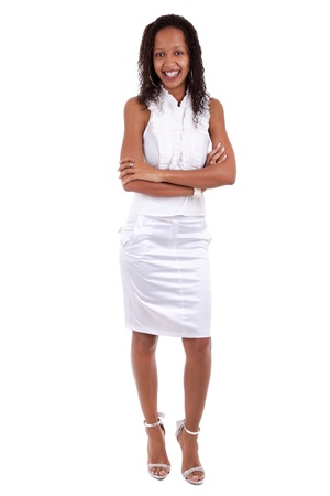 Portrait of a young beautiful african american woman with folded arms, over white background photo