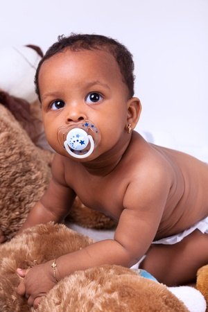 nipple young: Adorable little african american baby girl  looking up Stock Photo