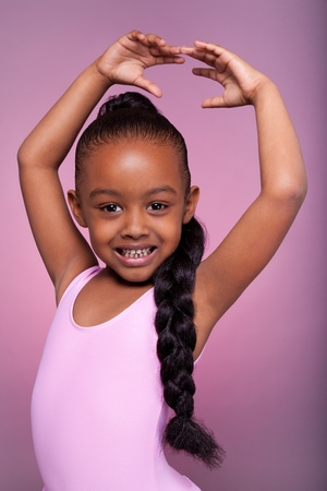 plait: Portrait of a cute little African American girl dancing