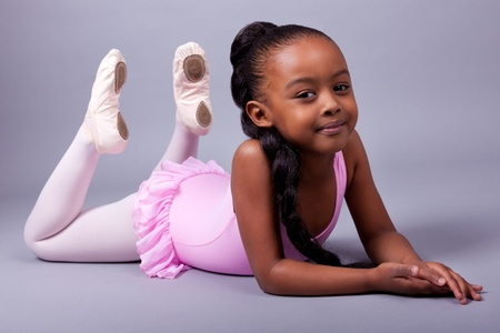 Portrait of a cute little African American girl wearing a ballet costume photo