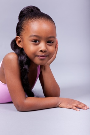 mixed ethnicities: Portrait of a cute little African American girl smiling