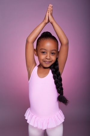 mixed race ethnicity: Portrait of a cute little African American girl dancing