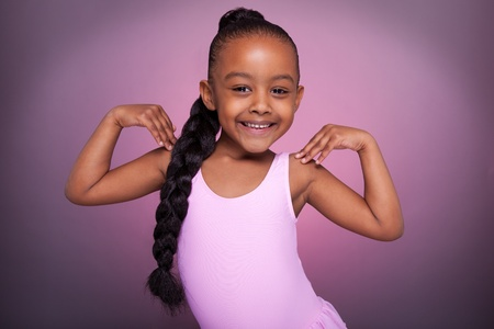 biracial: Portrait of a cute little African American girl dancing