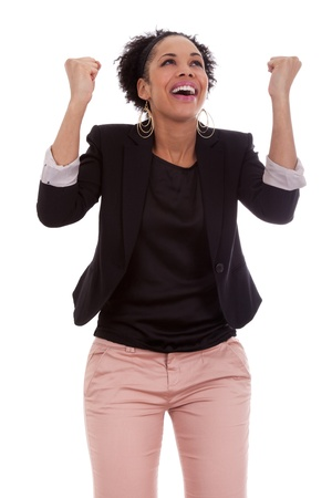 woman looking up: African american woman celebrating success with clenched fists on white background Stock Photo