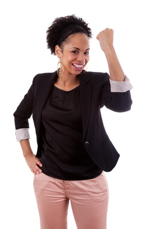 African american woman celebrating success with clenched fists on white background photo
