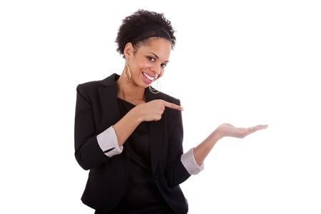 Young african american woman presenting something on empty palm, over white background photo