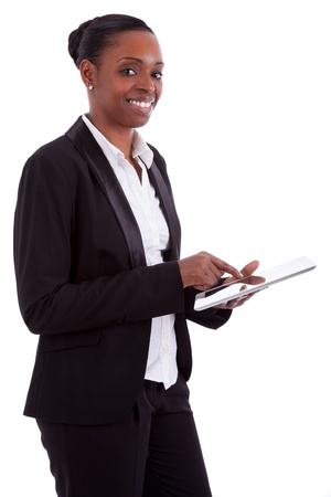 Smiling african american businesswoman using a tablet, isolated on white background photo