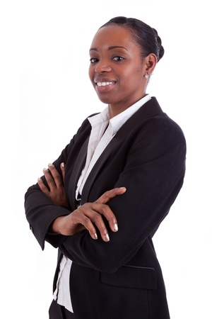 Smiling african american businesswoman with folded arms, isolated on white background Stock Photo - 12043612