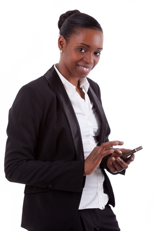 Smiling african american businesswoman using a smartphone, isolated on white background photo