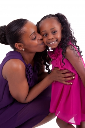 african american mother and daughter: Happy african mother kissing her daughter, isolated on white background Stock Photo