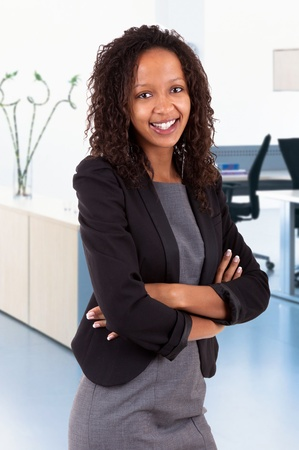 african american woman business: Smiling african american business woman with folded arms