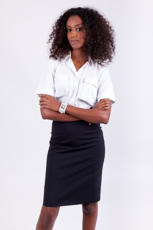 Smiling african american business woman with folded arms Stock Photo - 12321317