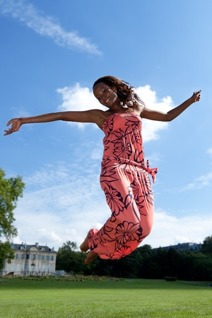 happy african woman: Outdoor portrait of a young beautiful african american girl
