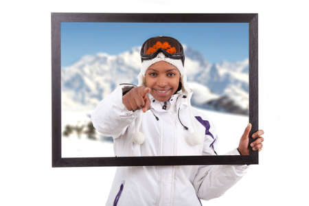 Young smiley woman in ski gears  holding a picture frame, isolated on white background Stock Photo - 12594562