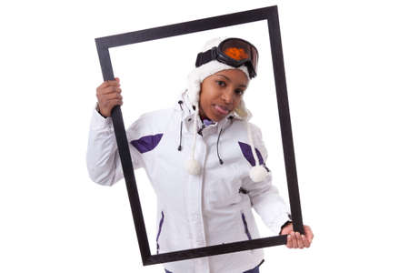 Young african woman in ski clothes  holding a picture frame, isolated on white background photo
