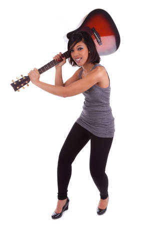 Young black woman breaking a guitar, isolated on white background Stock Photo - 12594687