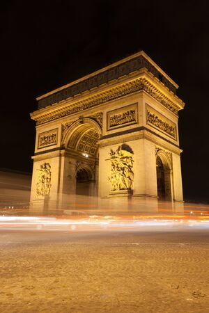 Arc de Triomphe - Arch of Triumph by night in Paris, France photo