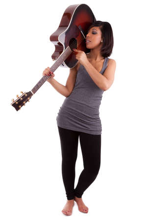 Young black woman playing guitar, isolated on white background Stock Photo - 12594704