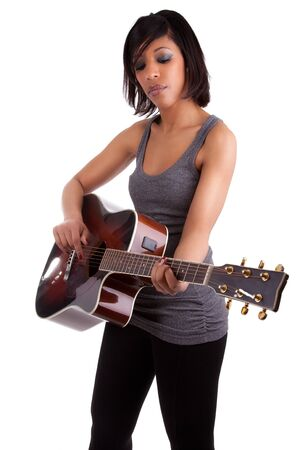air guitar: Young black woman playing guitar, isolated on white background