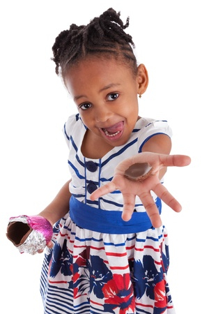 eating chocolate: Little african american girl eating chocolate easter egg, isolated on white background