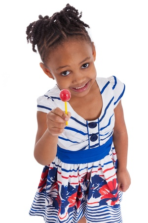 Portrait of a cute little african american girl with a lollipop, isolated on white background Stock Photo - 12812442