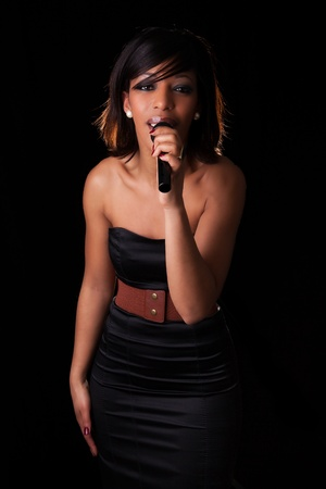 Young african american singer performing at concert photo