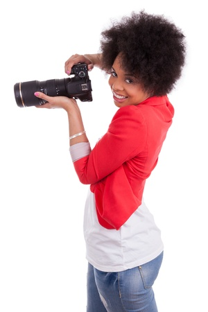 Young african american  photographer with camera, isolated on white background photo