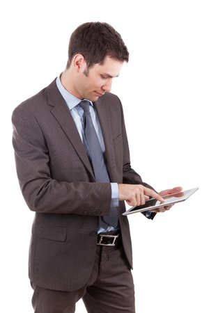Young caucasian businessman using a tablet pc,isolated on white background photo