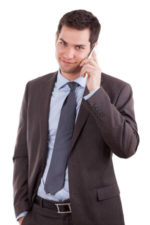 happy young man: Portrait of a young caucasian business man using a mobile phone,isolated on white background Stock Photo
