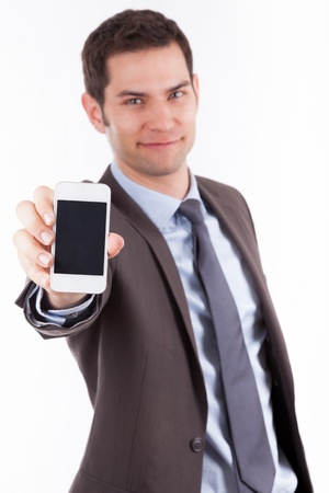 Young cuacasian businessman  showing something on a smartphone, isolated on white background photo