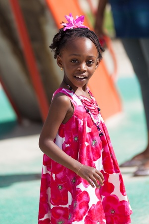 Outdoor portrait of a cute african american little girl photo