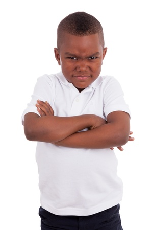 black children: Portrait of a angry  african american little boy, isolated on white background Stock Photo
