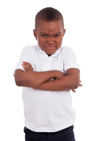 ni�os africanos: Retrato de un ni�o enojado africano americano, aisladas sobre fondo blanco Foto de archivo