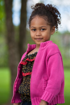 asian afro: Outdoor portrait  of a cute little African Asian girl