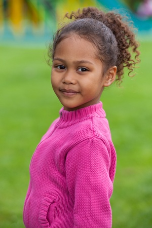 mixed race baby: Outdoor portrait  of a cute little African Asian girl