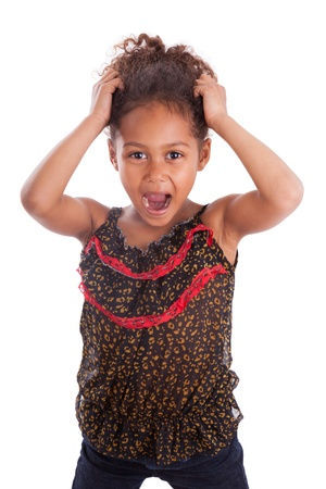 mixed race ethnicity: Little African Asian girl holding her head,  over white background