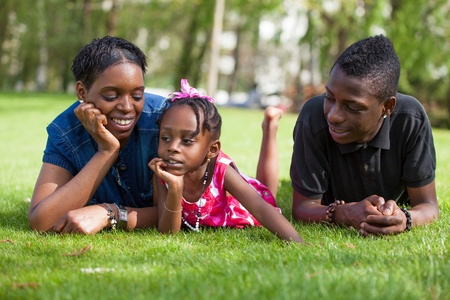 Portrait of a adorable african mother with her childrens in the garden photo
