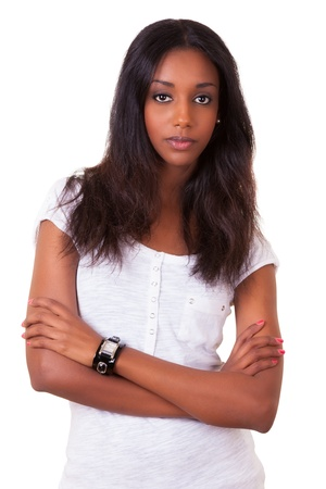 south american ethnicity: Portrait of a beautiful young black woman with folded arms isolated on white background