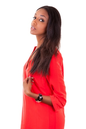south american ethnicity: Portrait of a beautiful young black woman in red dress, isolated on white background